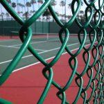 Chain link fence around tennis court