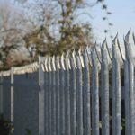 Line of metal palisade security fencing
