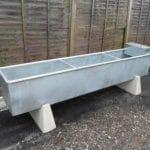 Metal feeding trough