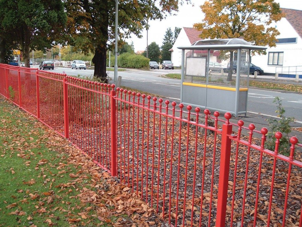 Red ball top fencing along footpath