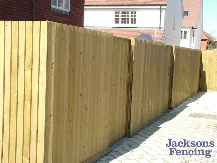 Featherboard wooden fencing on housing development