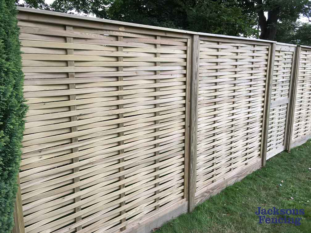 Woven wooden fence panels in garden