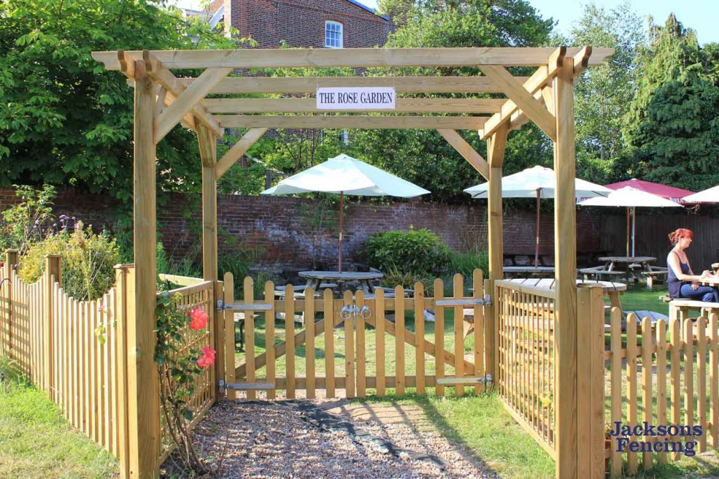 Wooden pergola and small picket gate